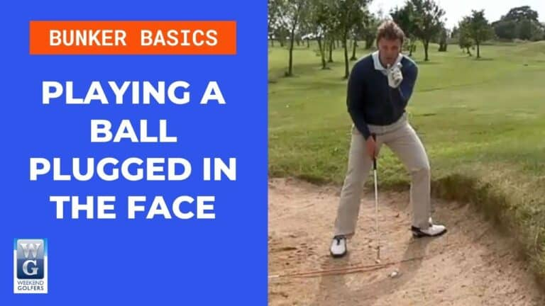 playing a ball plugged in the face of the bunker