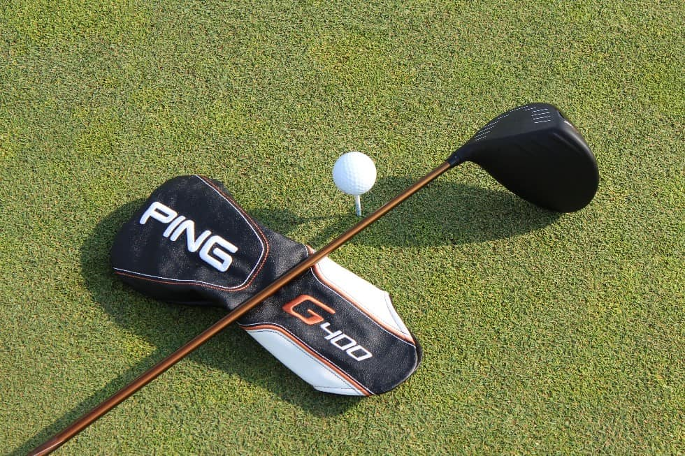 Ping G400 Driver and Headcover laying on grass